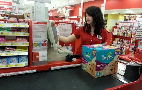 Senior Kristin Landrum rings up a customer's items. She has been employed at Target for the past five months.
