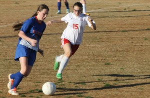 Sophomore Ali Hill chases after the ball and scored three games this match.