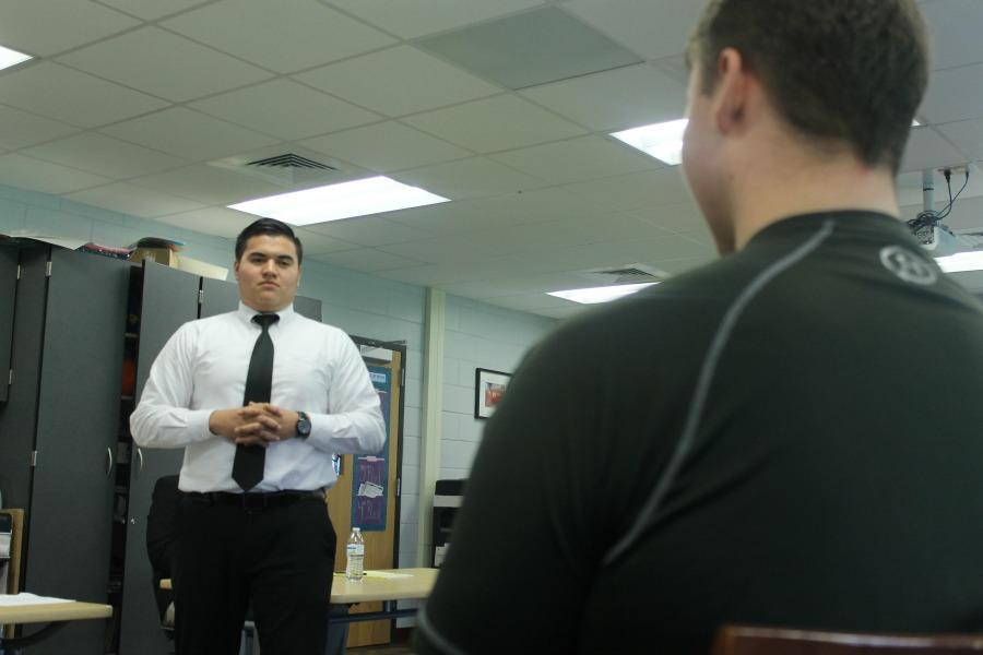 Senior Carlos Alarcon, defensive attorney, question junior Dylan Haley.