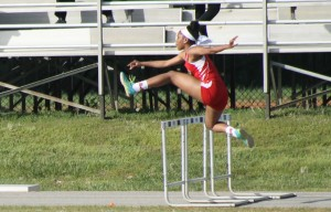 Sophomore Tomarri Lee jumping in the 100 hurdles event