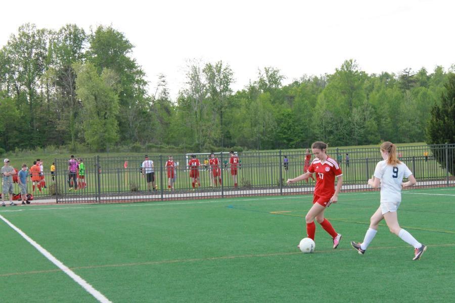 Senior Rhayne Tucker dribbles the ball past a Magna Vista Player