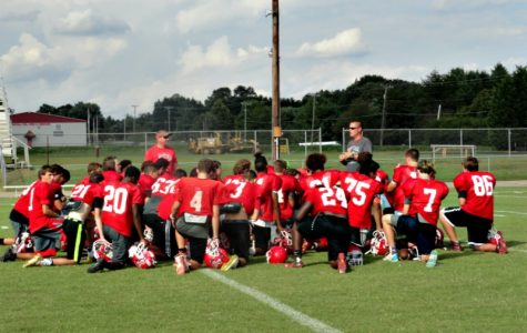 Coach David Potts huddles his team around after practice as he discuss his plans for tomorrows game vs. Rustburg