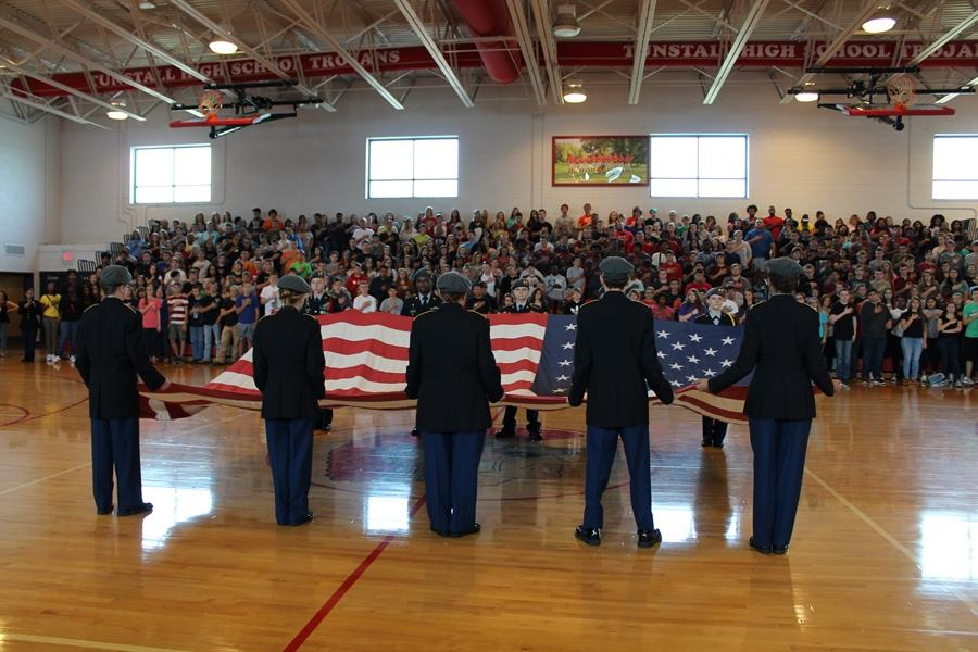 JROTC+students+present+the+flag+for+the+pledge+and+national+anthem.+