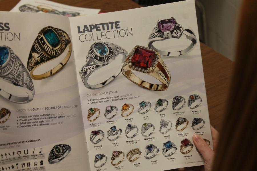 A student looks at the Lapetite collection on page 17 of the catalog.