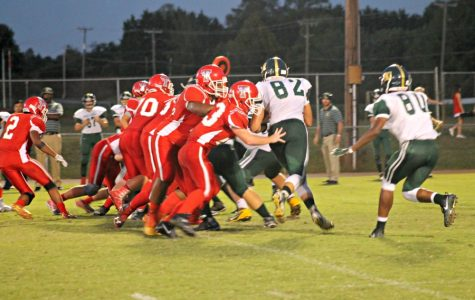 Tunstall's offensive line blocks the Cougars defense as Lovelace carries the ball