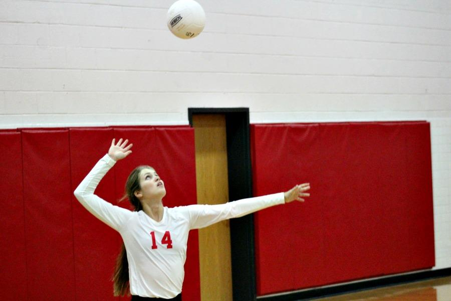 Zoey White goes for a serve in Thursdays night match vs. GW