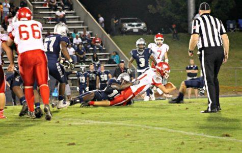 Quarterback Luke Buckner scrambles for the first down.