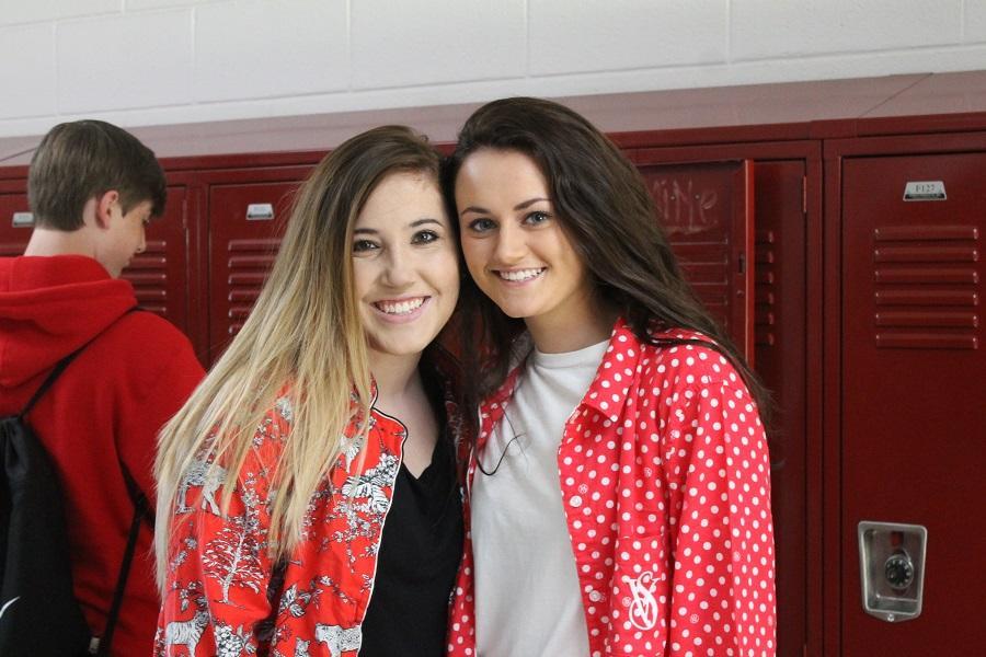 Friends Allie Gentry and Jordan Hawkins wear similar pajamas.