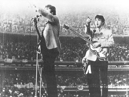 The Beatles making a historic performance at Shae Stadium.