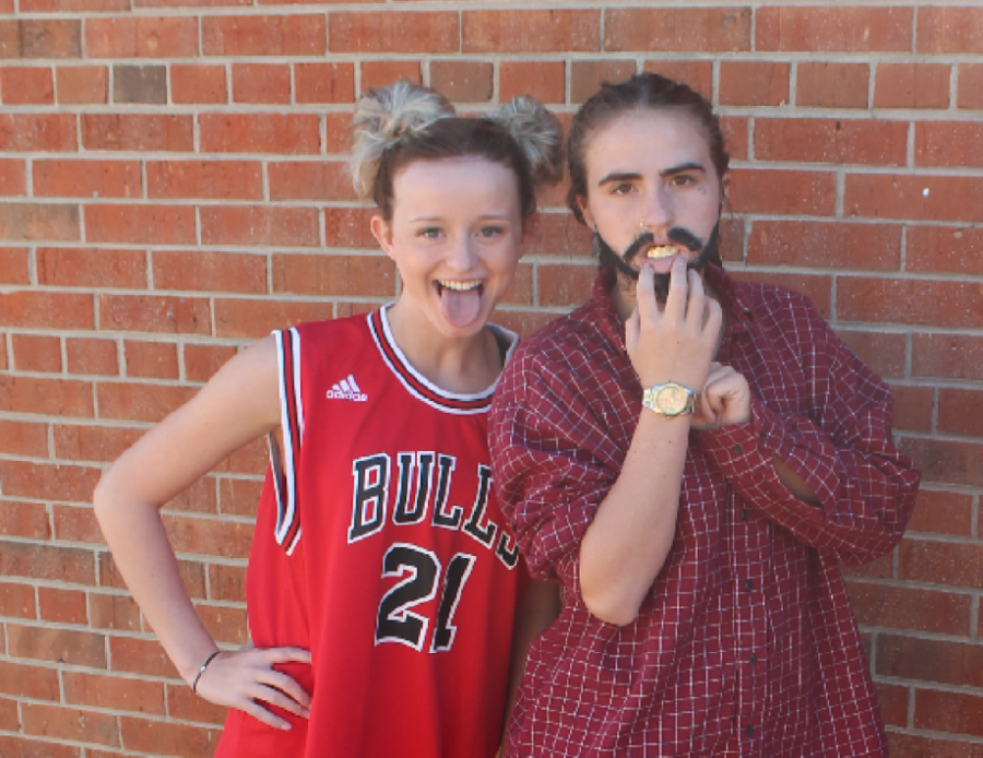 Leah is on the right in her Post Malone spirit week costume next to senior Cayla Fuqua, who is dressed as Miley Cyrus.