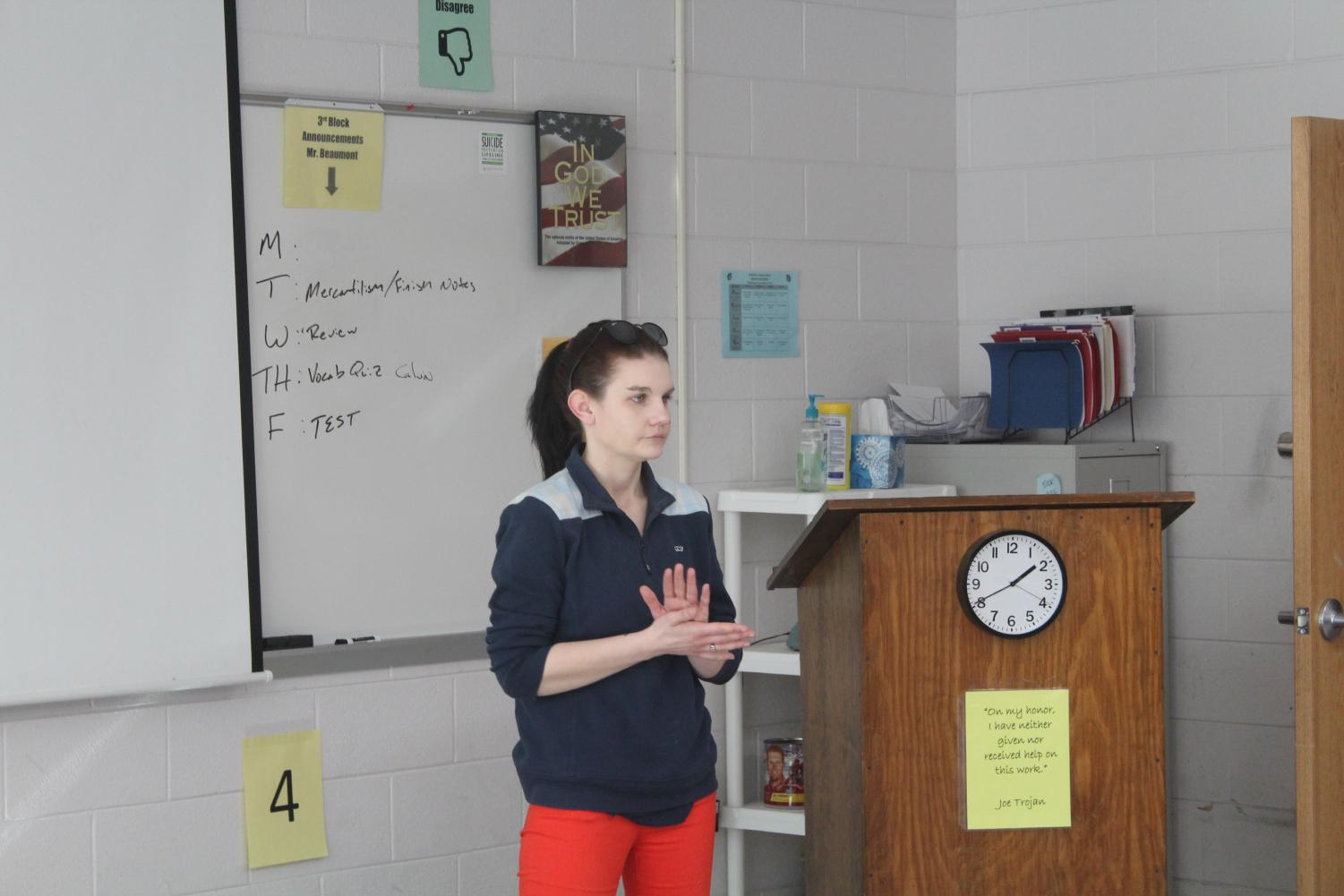 Ms. Holt visited Mr. Book's government class to answer questions about FASFA and remind students of upcoming college nights.