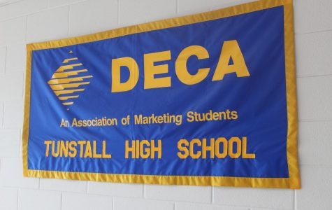 DECA students dominate in districts