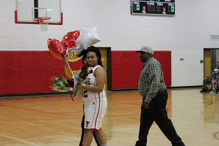 Senior Makayla Gravely walking off the court after being recognized.