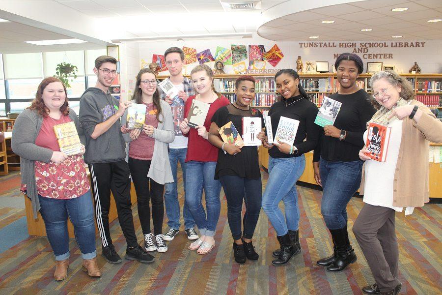 Students+from+AP+Literature+classes+show+off+their+books.+From+L+to+R%3A+seniors+Ava+Wood%2C+Blake+Mitchell%2C+Nicole+Tolley%2C+Jacob+Motley%2C+Jordan+Walker%2C+Mya+Godwin%2C+Oniandra+Jennings%2C+Lauren+Jackson%2C+and+Mrs.+Yeatts.+