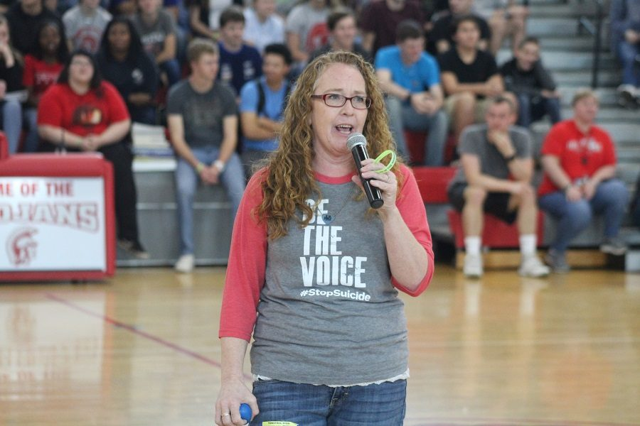 LeAnne Hardy speaks to Trojans during halftime at Fridays faculty/student basketball game.