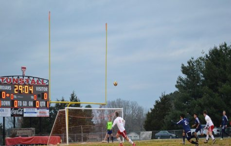 Senior Adam Scearcy watches the ball after making a shot to the goal.