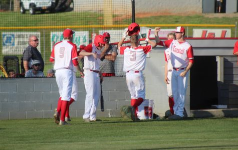 The Trojan Pack celebrates after bringing in two runs.