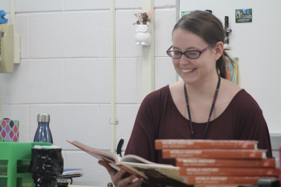 Ms. Brittany Atkins reviewing her World History 1 book