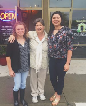 In their sophomore year, Sarah Lovern and Caitlin Giles enjoy an evening out at San Marcos with Mrs. Ayuso.