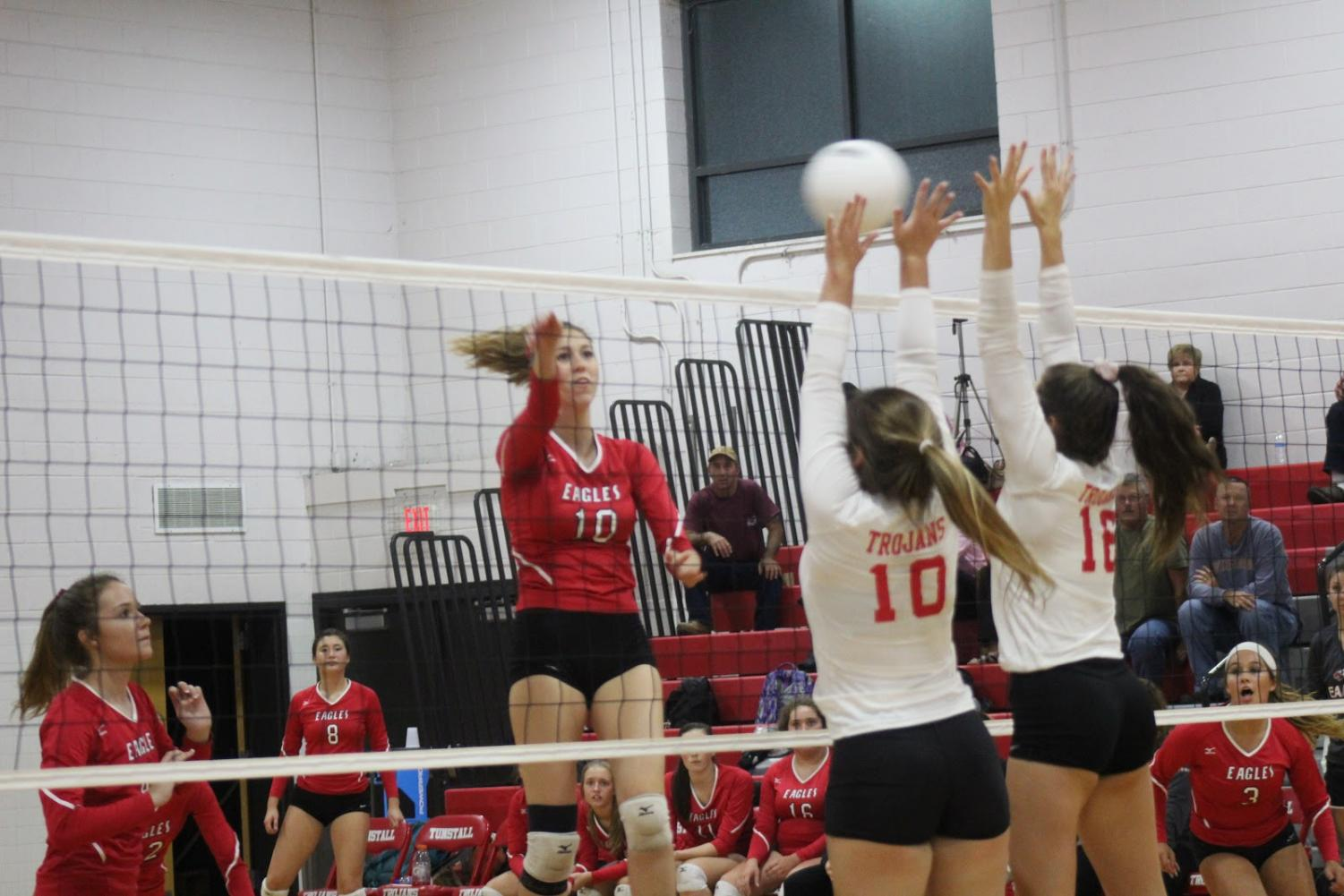 Kinsley Stevens and Brooklyn Owens block the ball against a strong Eagles offense.