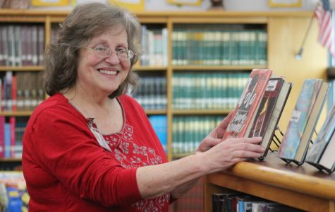 Librarian Linda Yeatts organizes library books