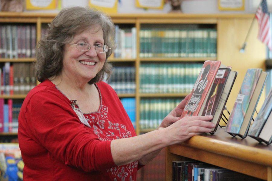 Librarian Linda Yeatts organizes library books