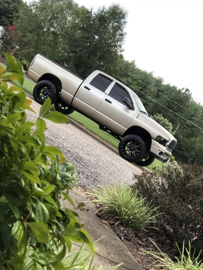 Senior+Ethan+Broyles%27+modified+gold+Dodge+Ram+Hemi+crew+cab.+