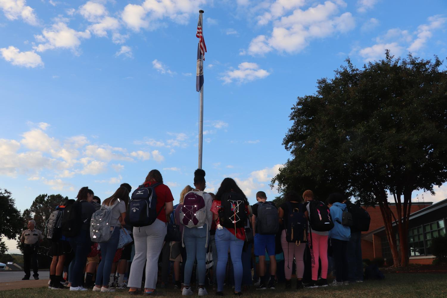 Students gather in prayer around the school's flagpole the morning of Wednesday, September 25.