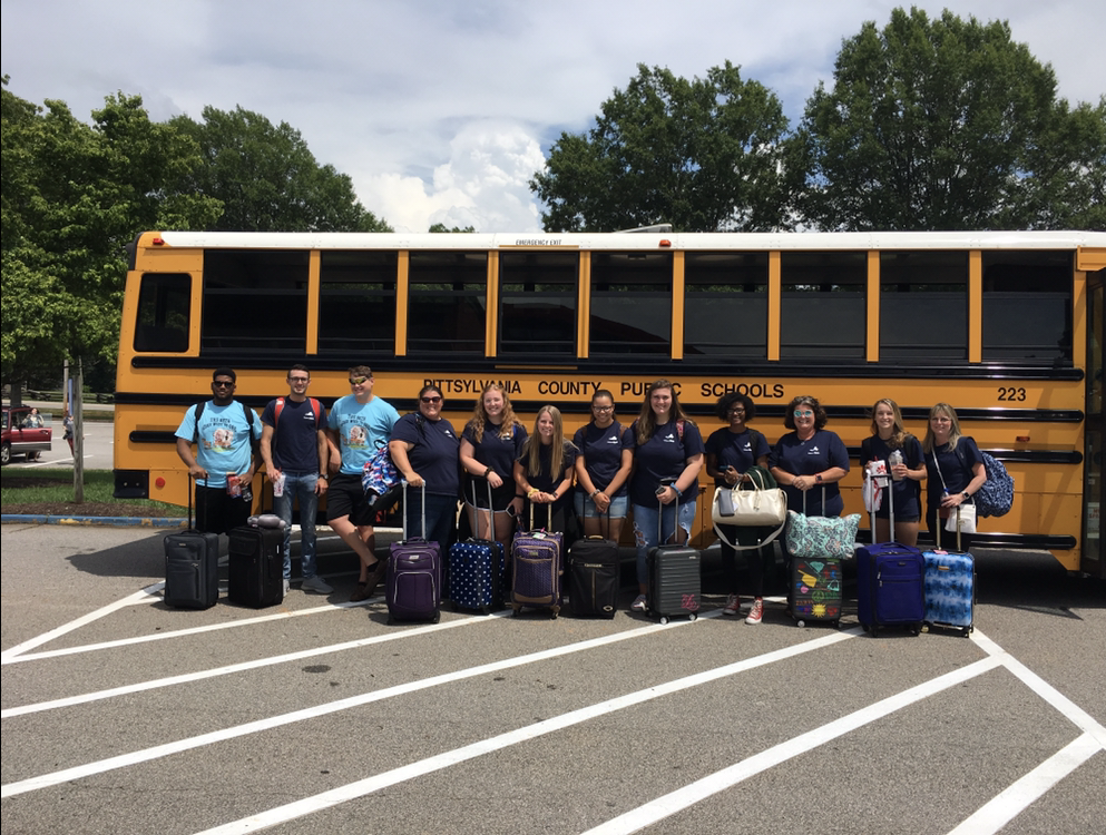 2018-2019 Beta members seen taking a picture in front of the bus as they depart for RDU airport.