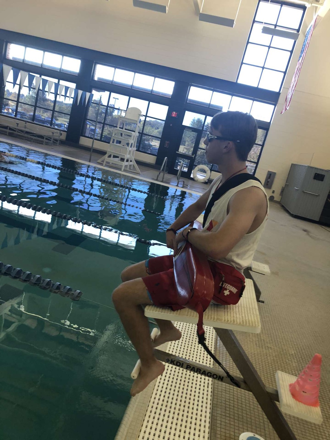 Sophomore Chaz Nickens watches over the people swimming at the Danville YMCA