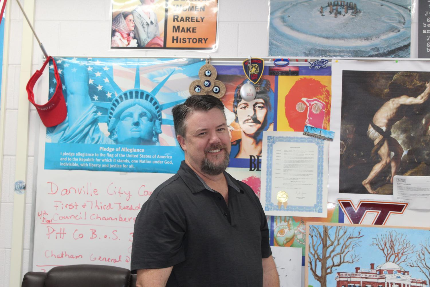 Social studies teacher Patrick Touart laughing while sporting his signature goatee.