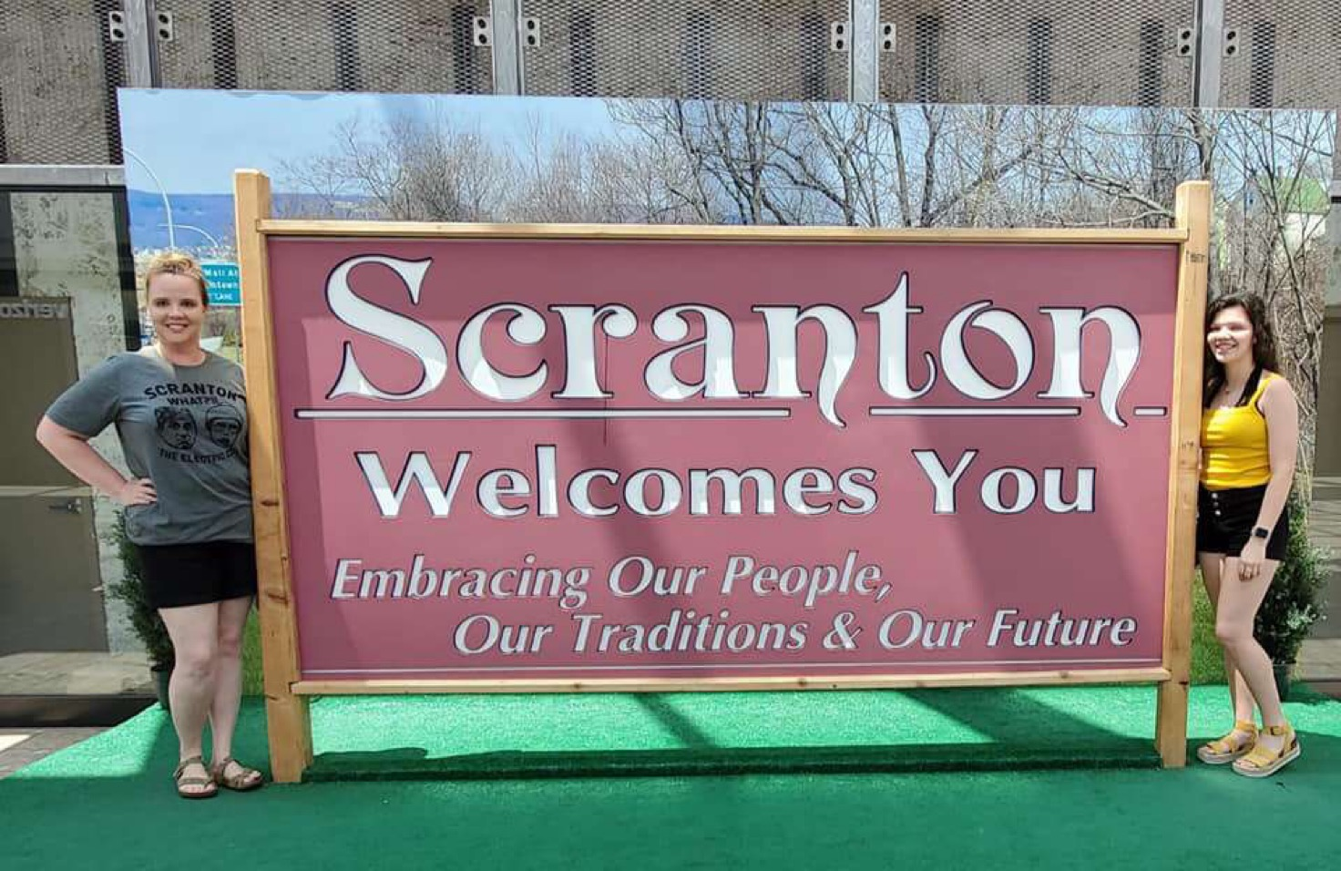 Junior Savannah Scearce poses with a sign in Scranton, Pennsylvania.