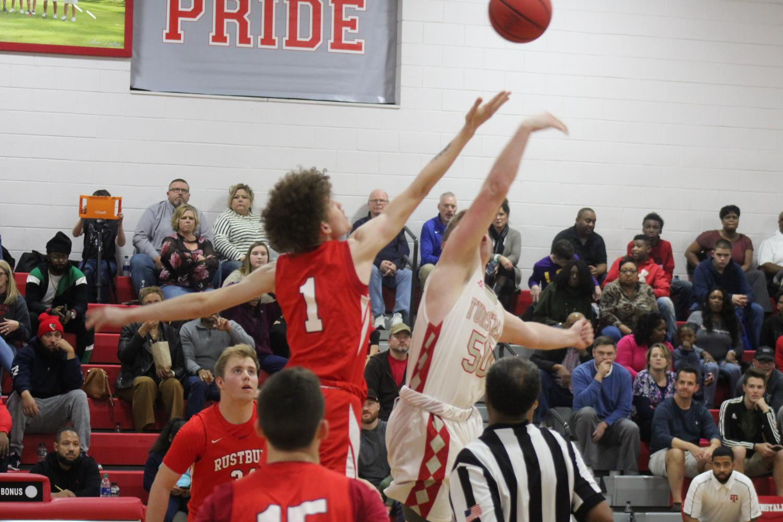 Junior Andrew Crank wins the tip-off against Rustburg High School.