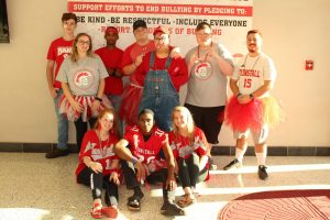 Alumni Trenton Eanes (top row, second from the right) posing with peers on spirit day.