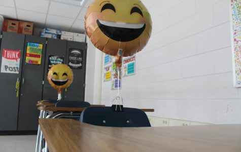 Mrs. Ray's classroom, with balloons as students.