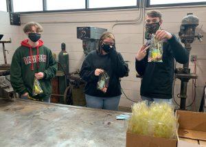 FFA putting together gift baskets for teacher appreciation week. (Caleb Almond, Alicia Cardwell, Corey Woods)